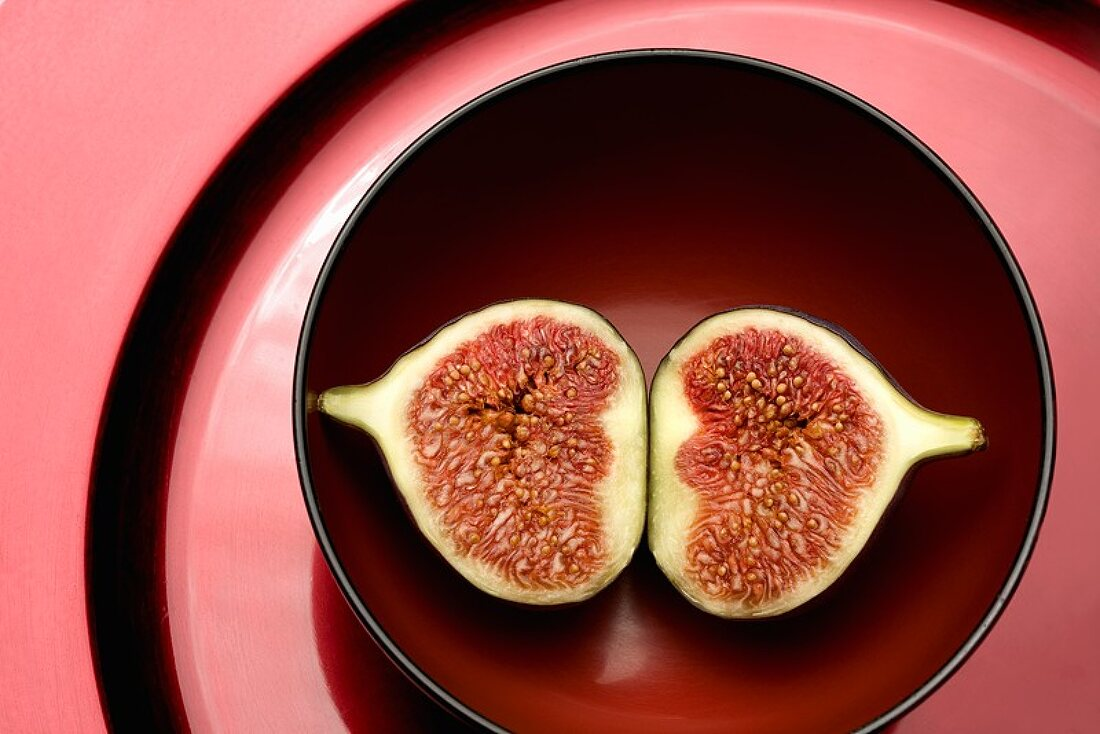 A halved fig in a dish
