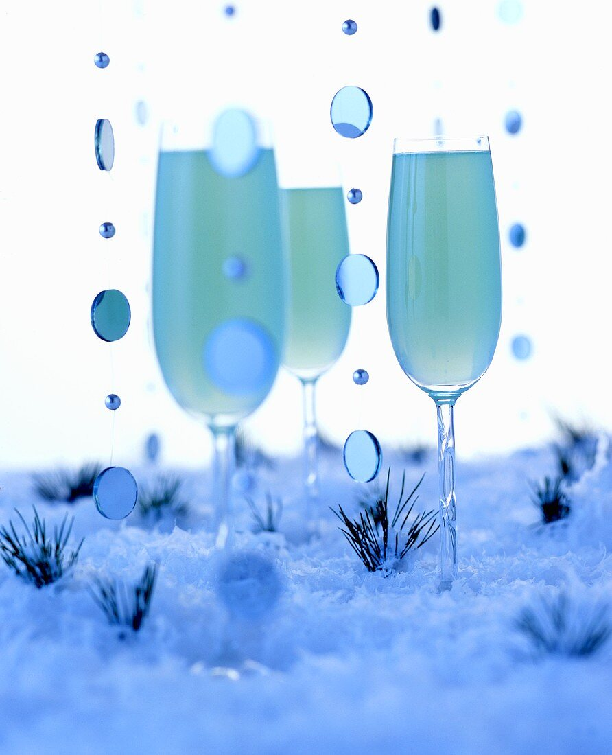 Blue winter drinks in artificial snow