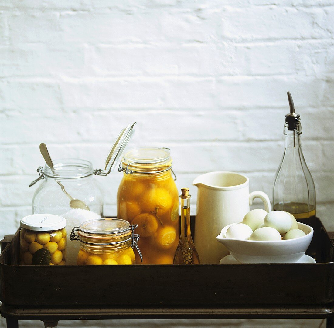 Eggs, bottled peaches and pickled onions on tray