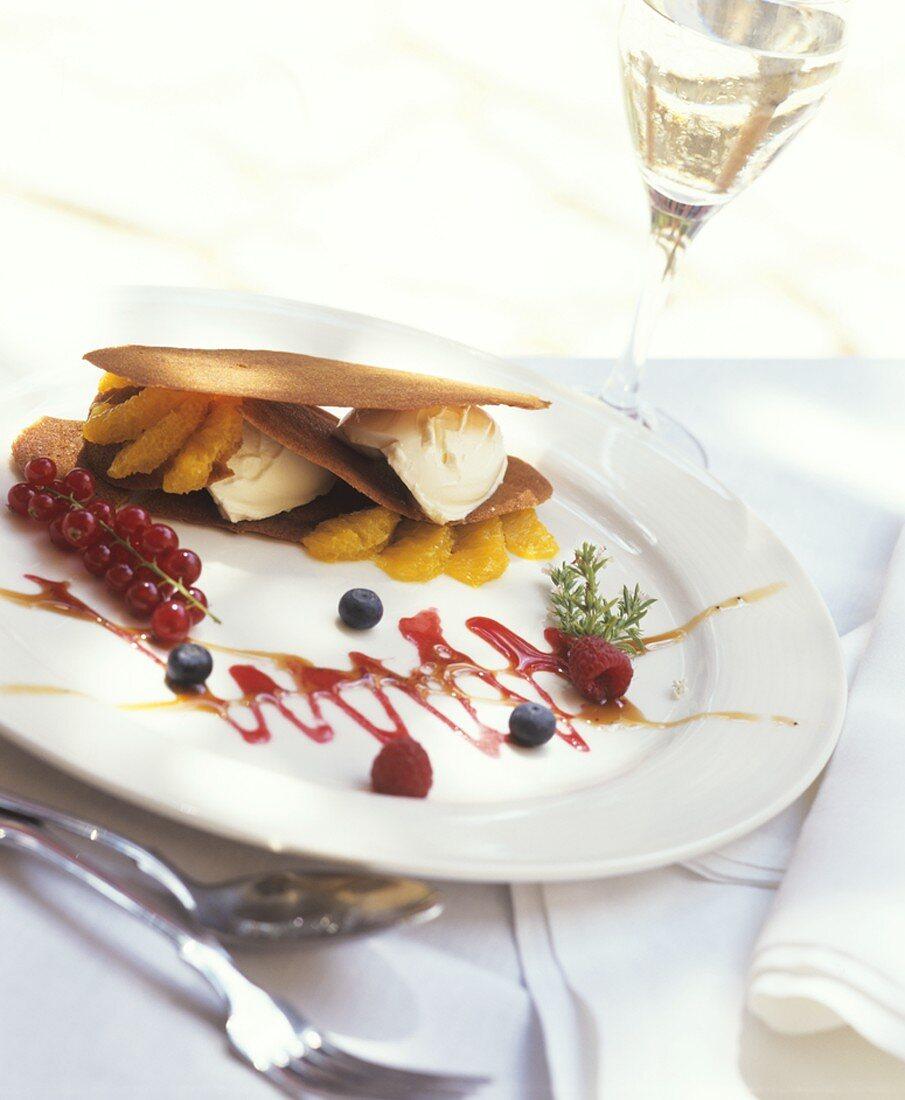 Ice cream dessert with wafers, berries and orange segments