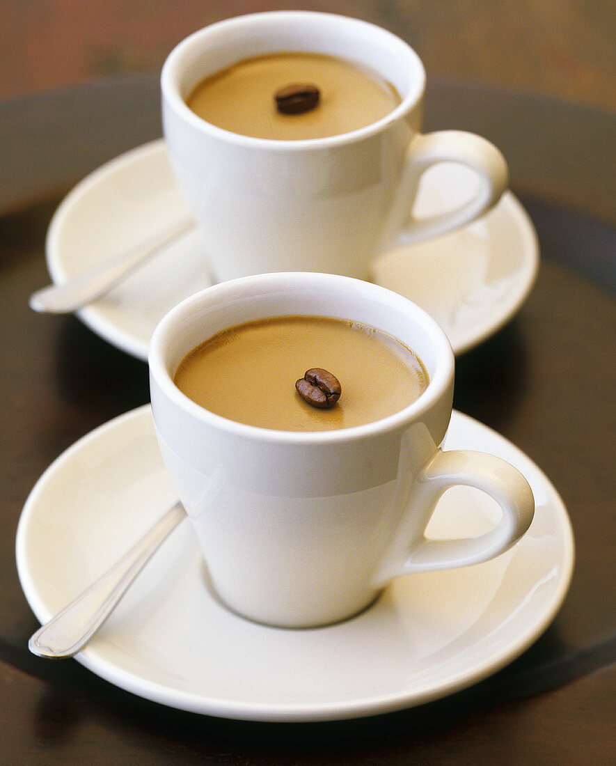 Coffee cream with coffee bean in cups and saucers