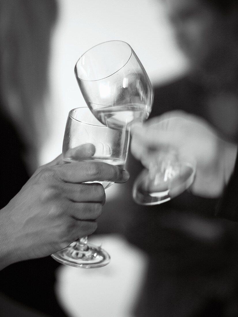 Clinking wine glasses