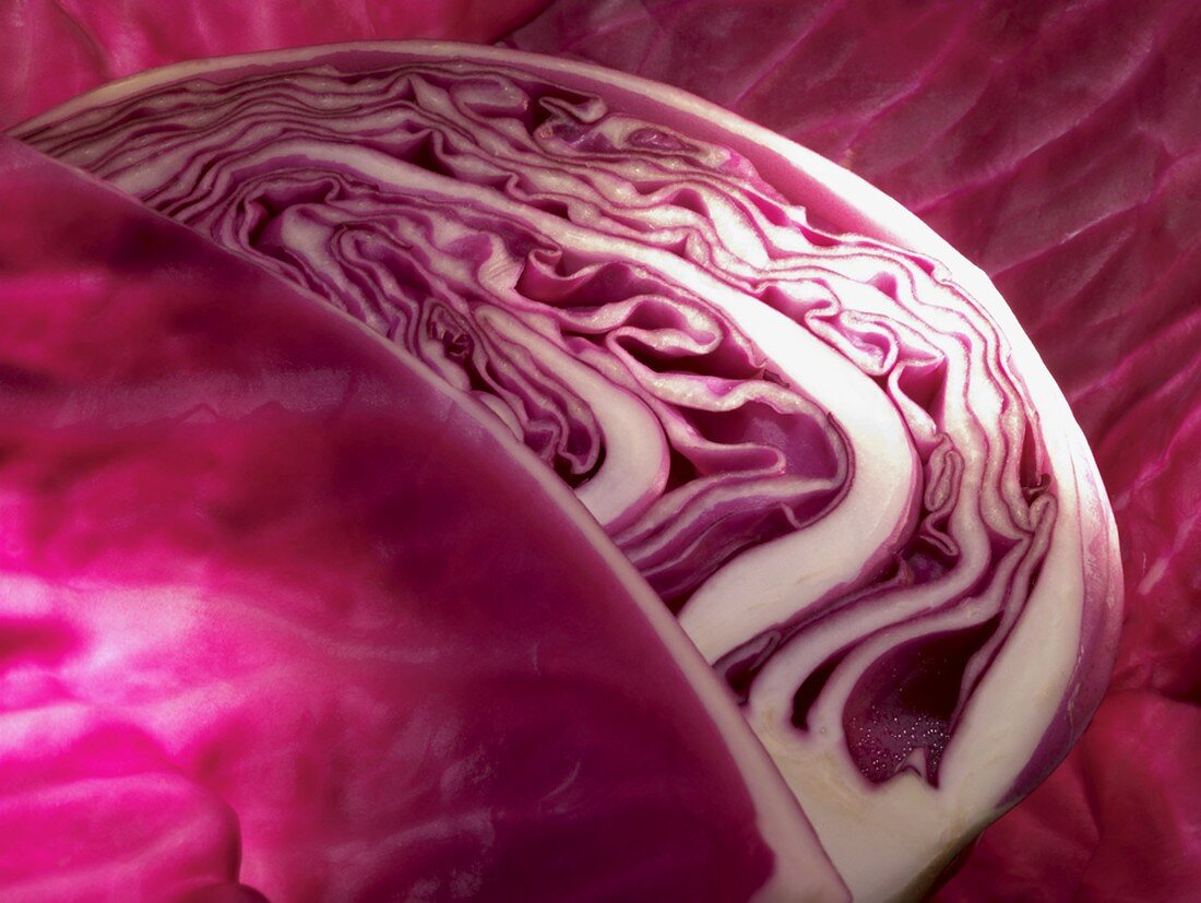 A red cabbage with a section removed