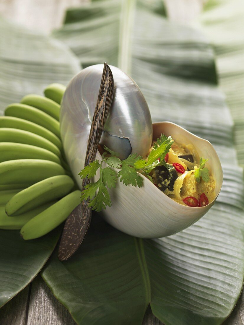 Chicken Colombo in a shell (Caribbean)