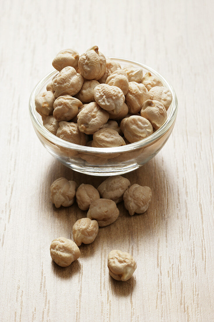 Dried chickpeas in a small glass dish