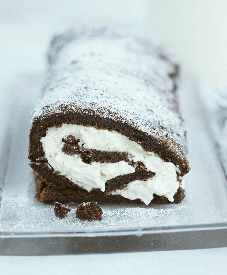 Chocolate sponge roulade filled with whipped cream