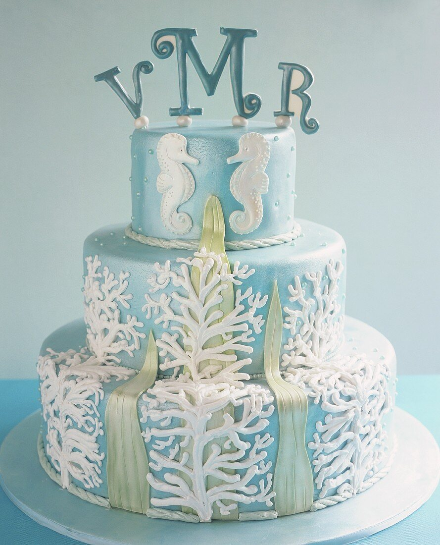 Three-tiered cake with seaweed, sea horses, initials