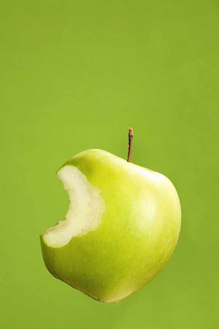 An apple with bite taken out of it