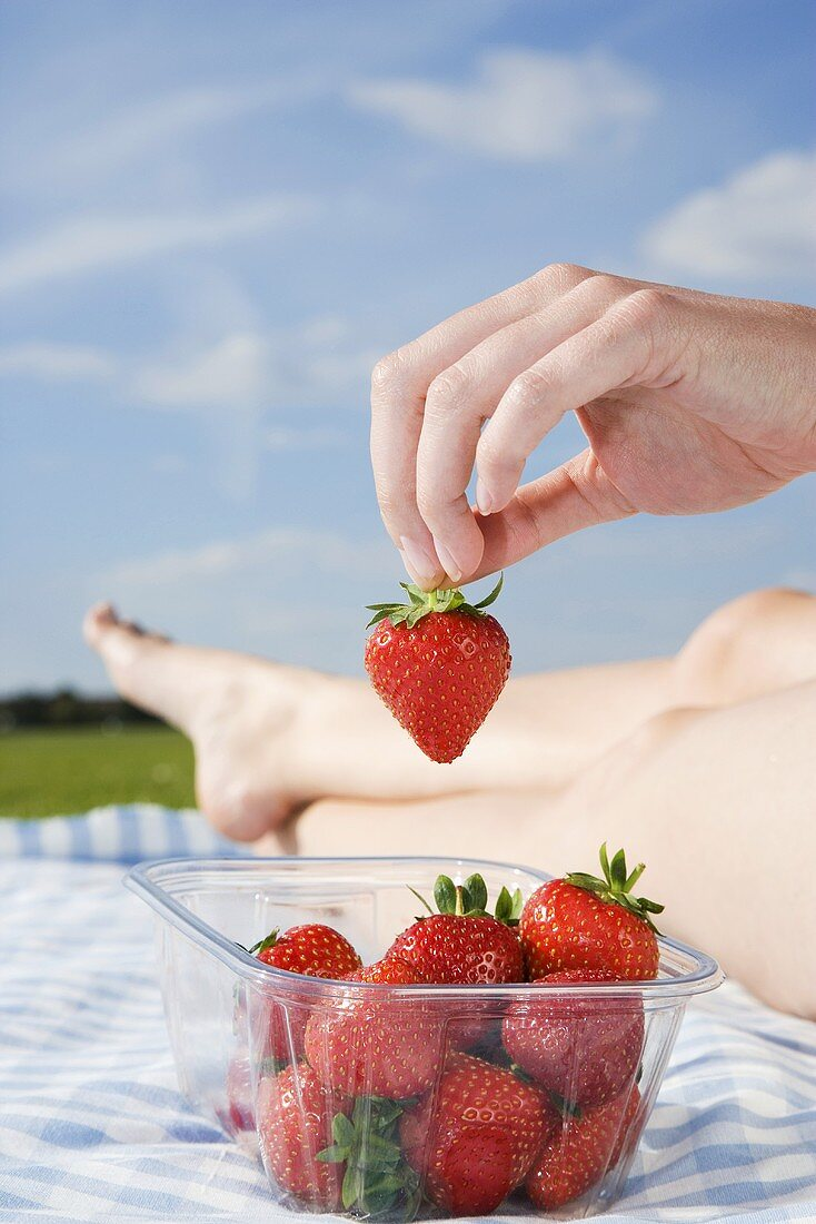 A woman with strawberries