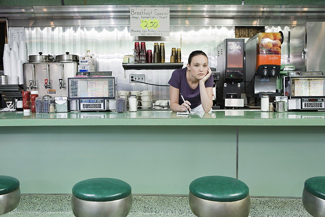 A bored waitress in a diner