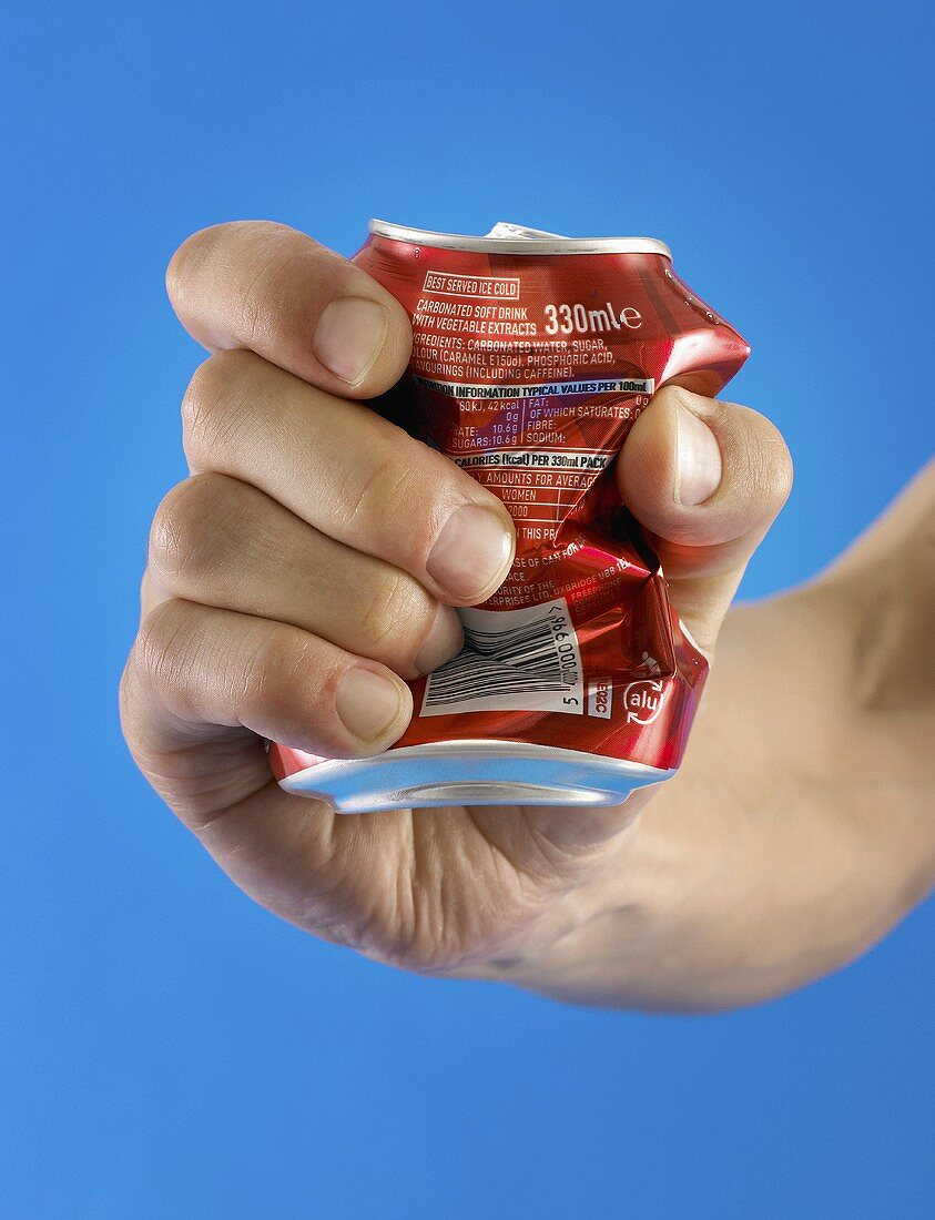 A person crushing a can in their hand