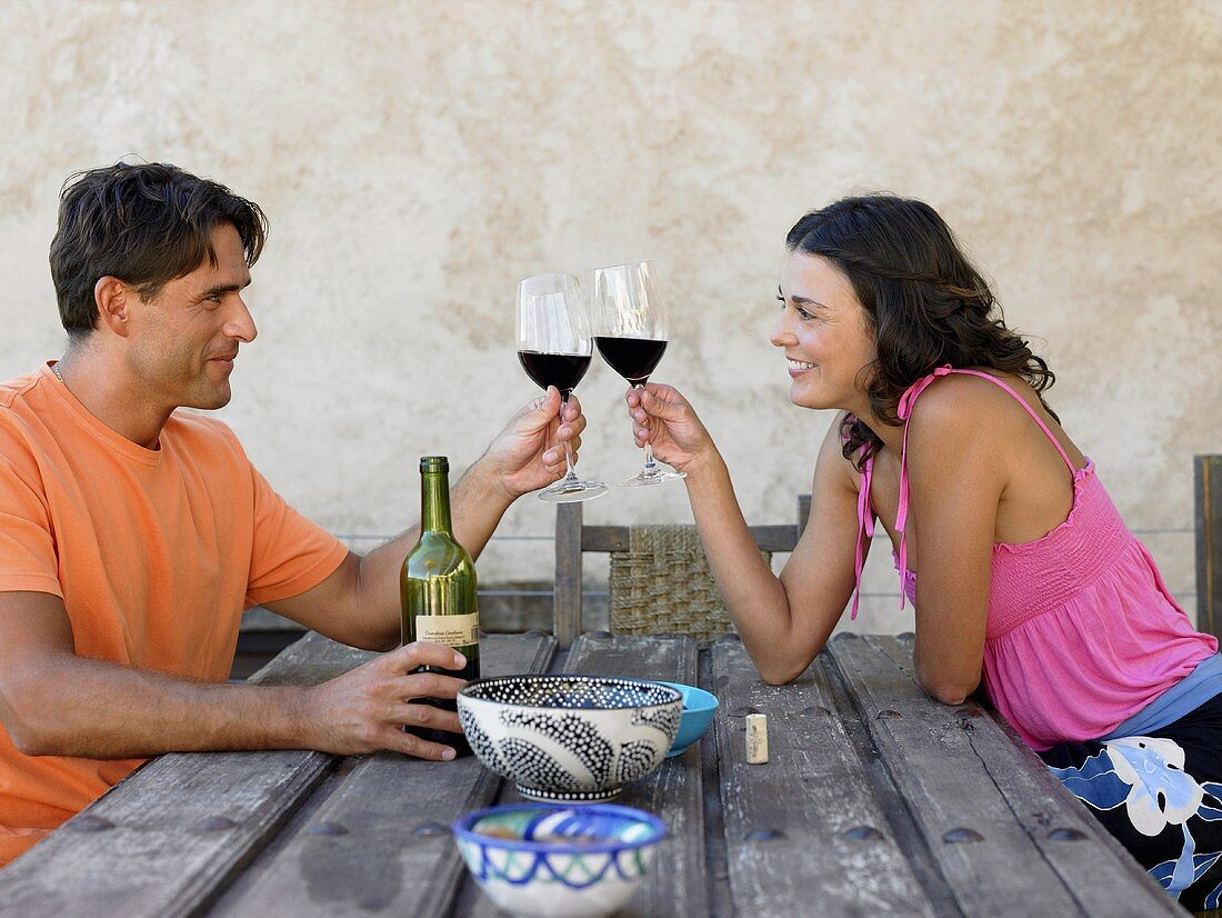 A couple toasting with wine