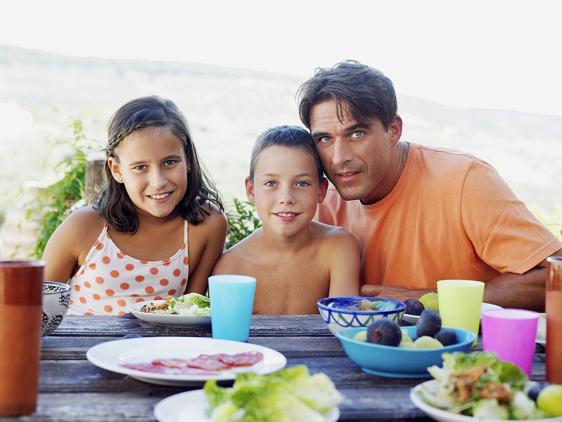 A father and children having a meal