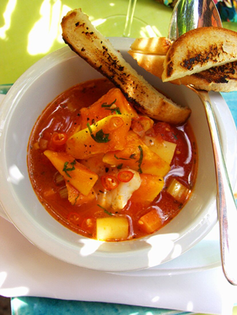 Spicy Creole fish soup with sweet potatoes