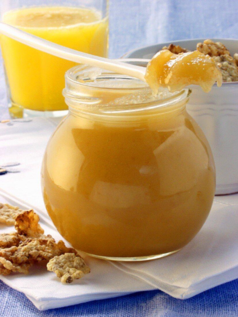 Blossom honey in jar & on spoon; cornflakes; orange juice