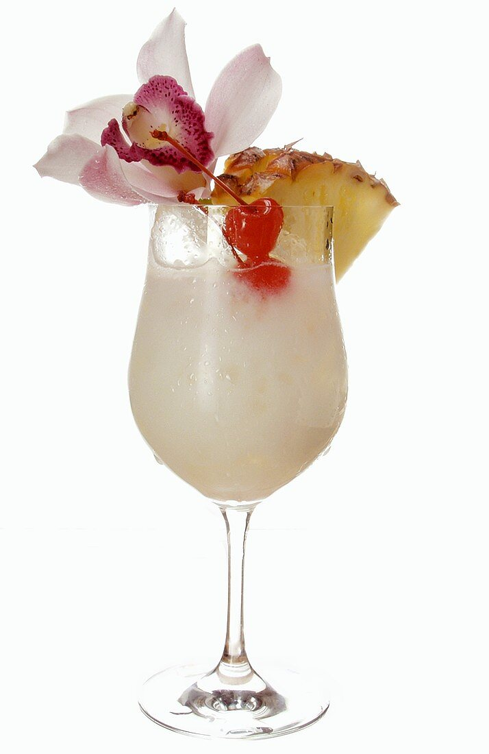 Caribbean drink with coconut milk and pineapple in glass