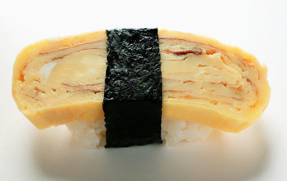 Nigiri sushi with egg and nori