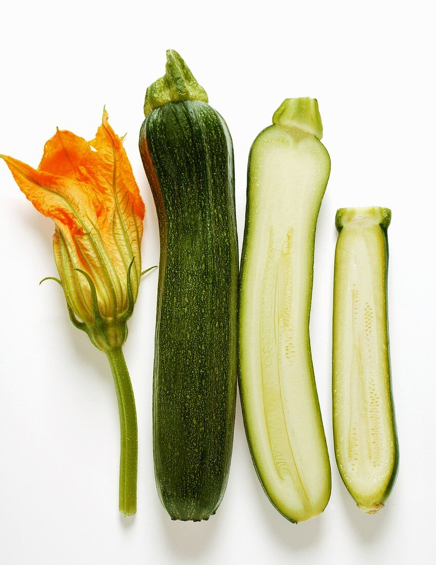 Courgette flower, whole and half courgettes