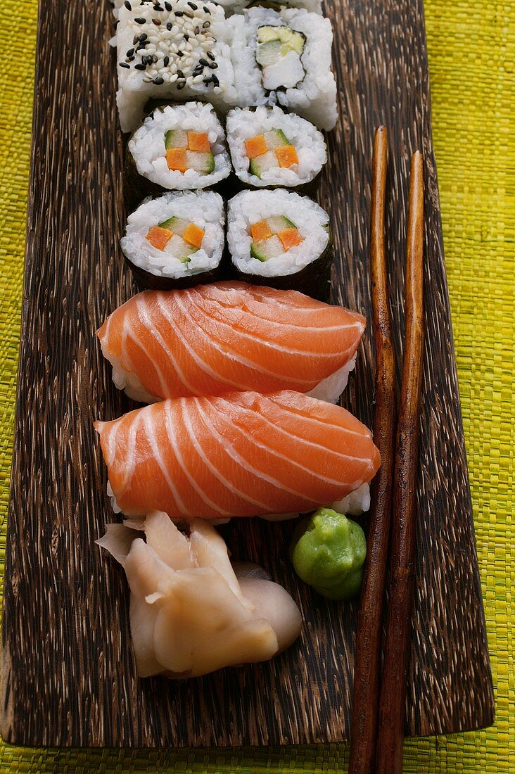 Nigiri-sushi and maki-sushi with ginger and wasabi