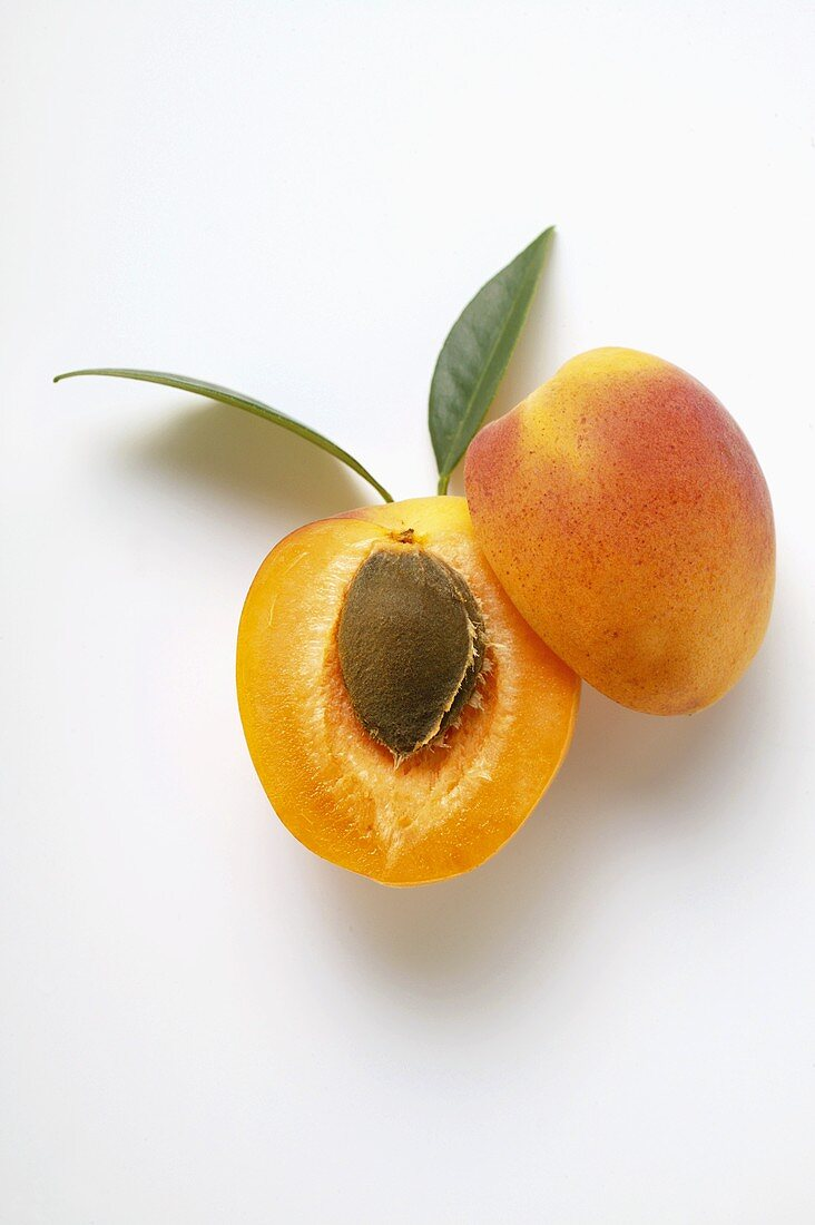 Apricot, halved, with leaves