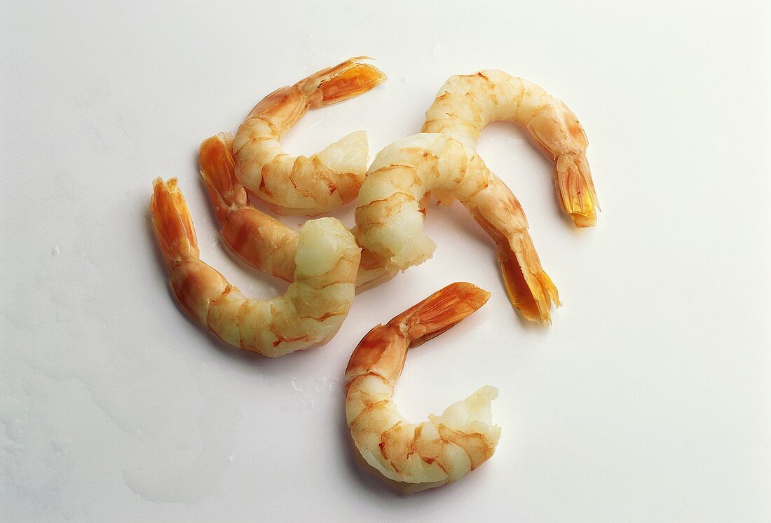 Several cooked, peeled shrimps