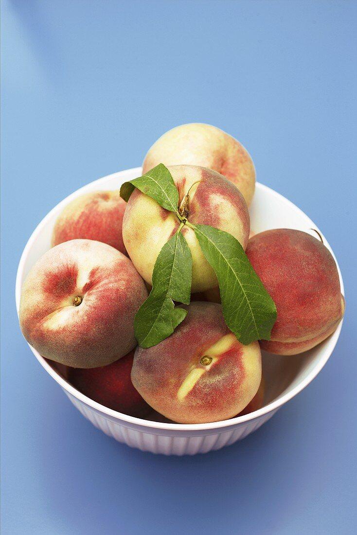 Fresh peaches in bowl