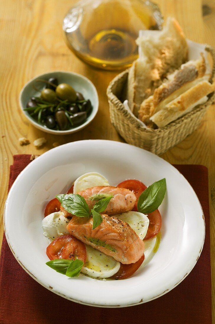 Tomatoes with mozzarella, salmon and basil