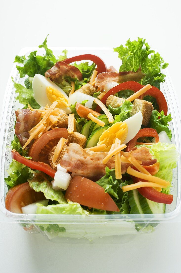 Salad leaves with vegetables, egg, cheese & bacon to take away
