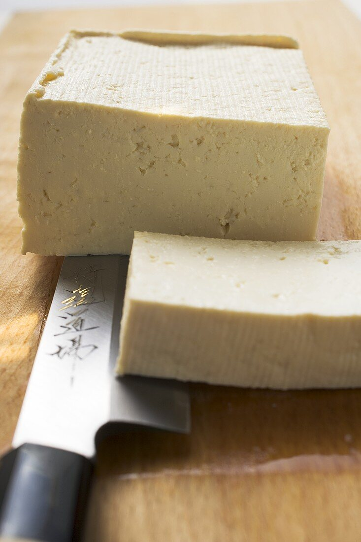 Block of tofu with a slice cut off
