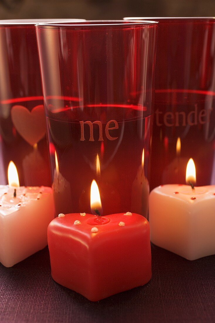 Three candles and red glasses for Valentine's Day