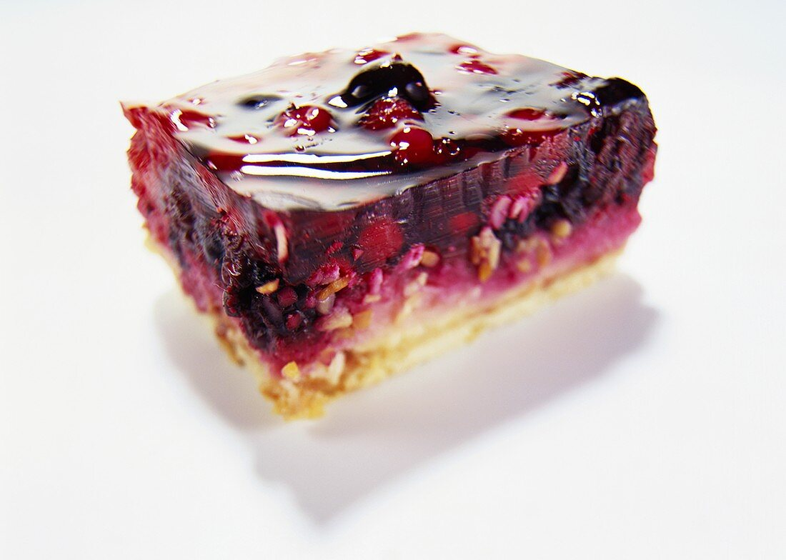 A piece of cake with red fruit