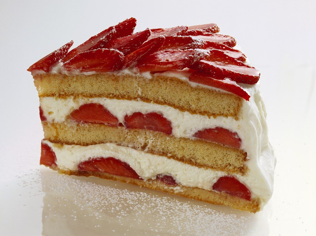 A piece of advocaat gateau with strawberries