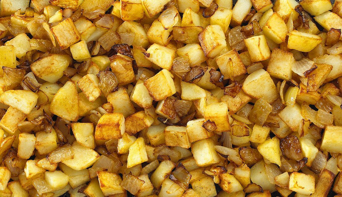 Fried potatoes with onions (filling the picture)