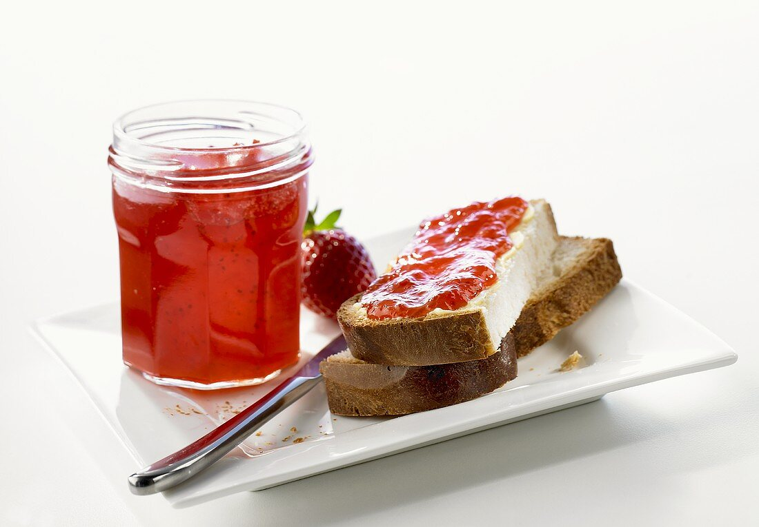 Strawberry jam in jar & on Blatz (sweet yeasted white bread)