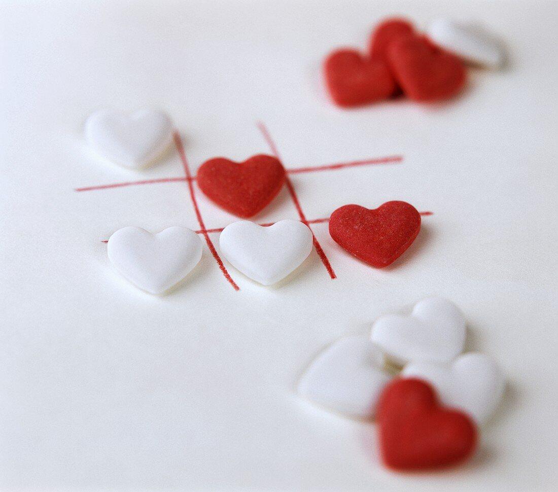 Several white and red grape sugar hearts