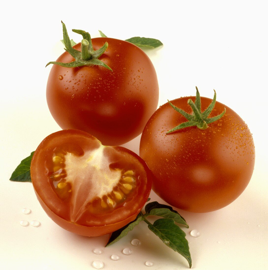 Two whole and one half tomato