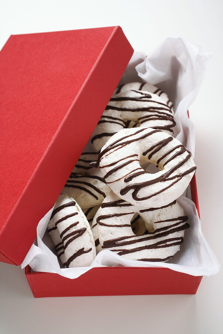 Almond and coffee macaroons in red gift box