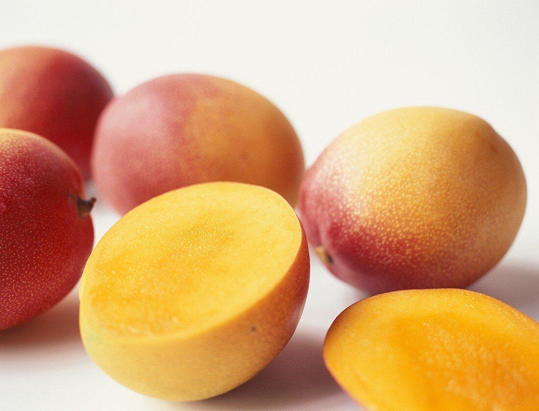 Fresh mangos, one halved