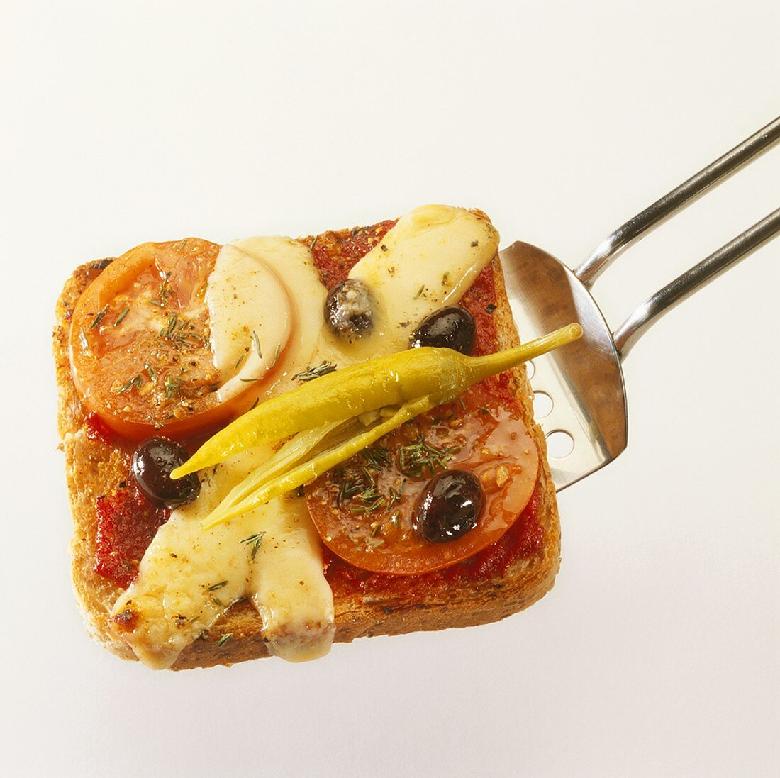 Chilli, tomato and cheese on toast