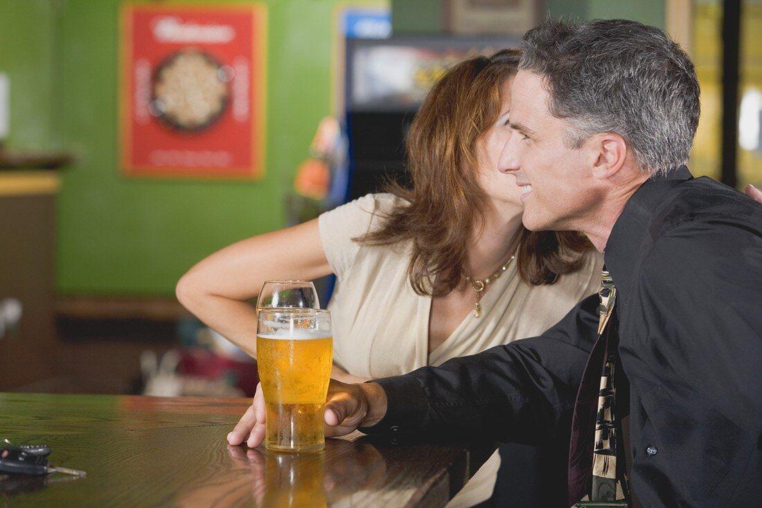 Man and woman at a bar