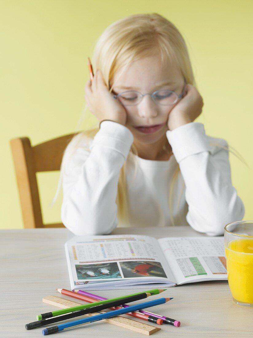 Girl reading a school book