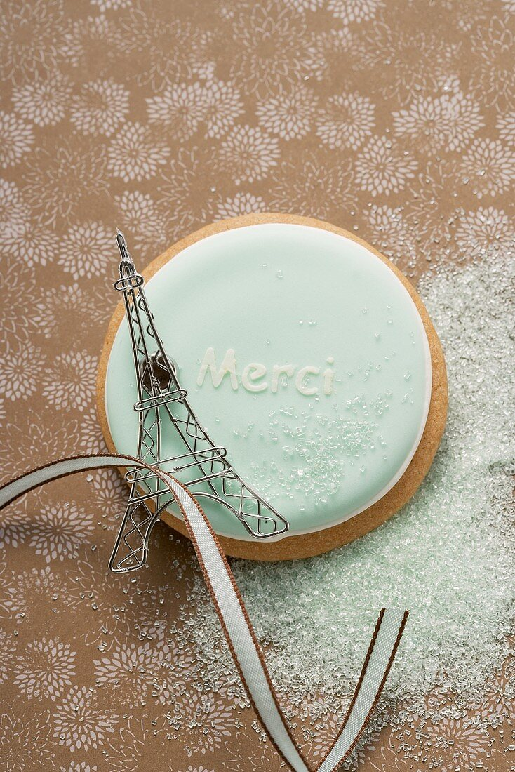 A Frencn biscuit with the word 'Merci'