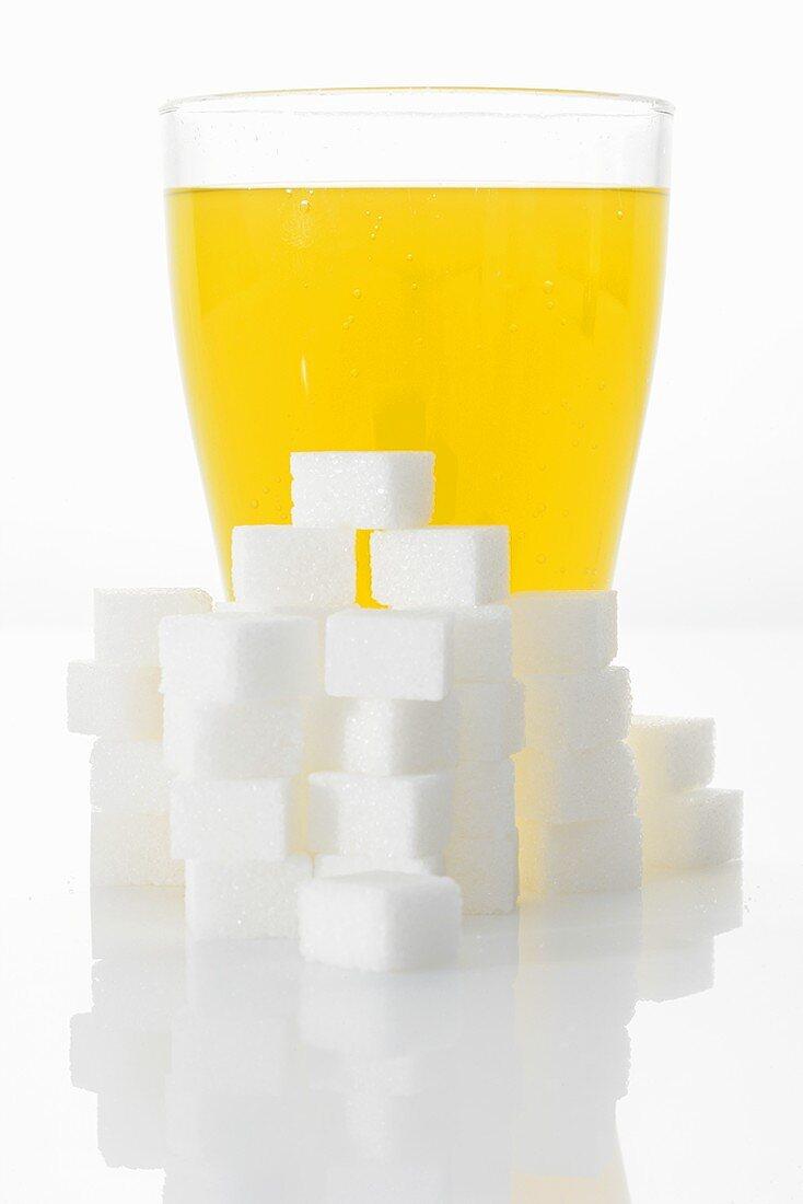Orangeade & sugar cubes (picture symbolising high sugar content)
