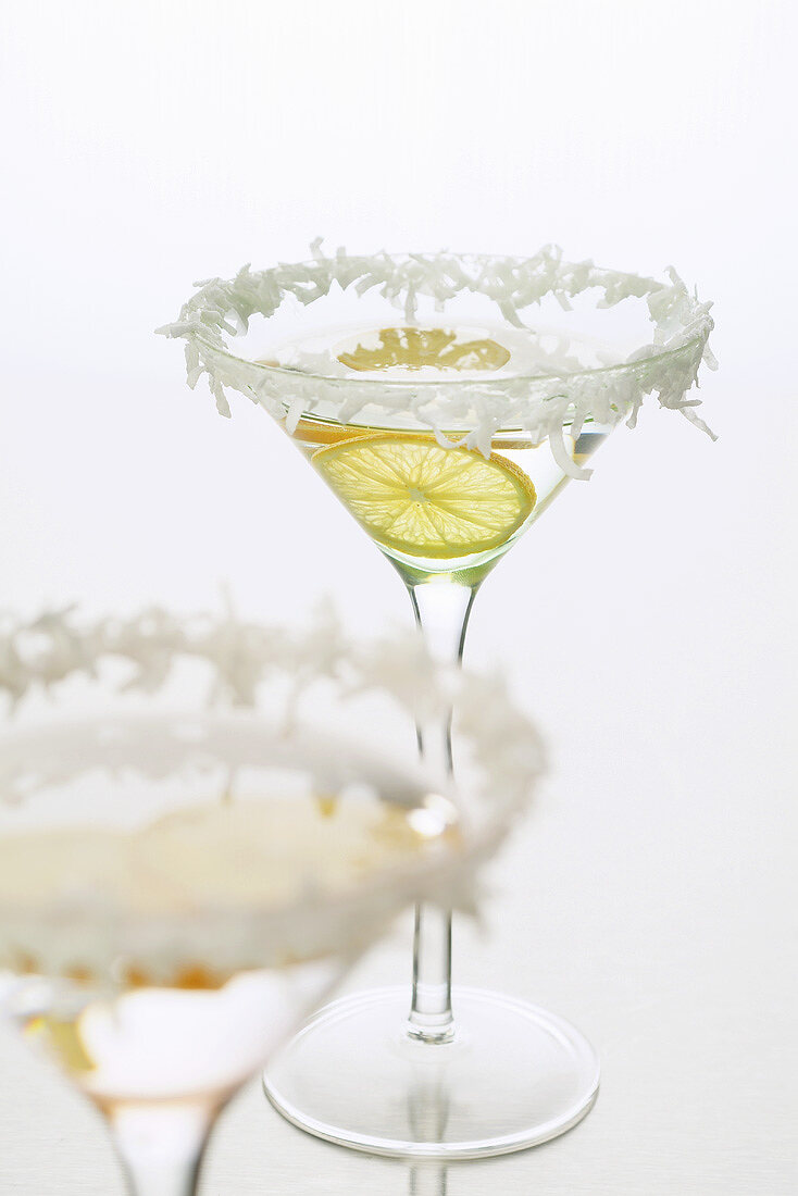 Sambuca with lemon in coconut-rimmed glass