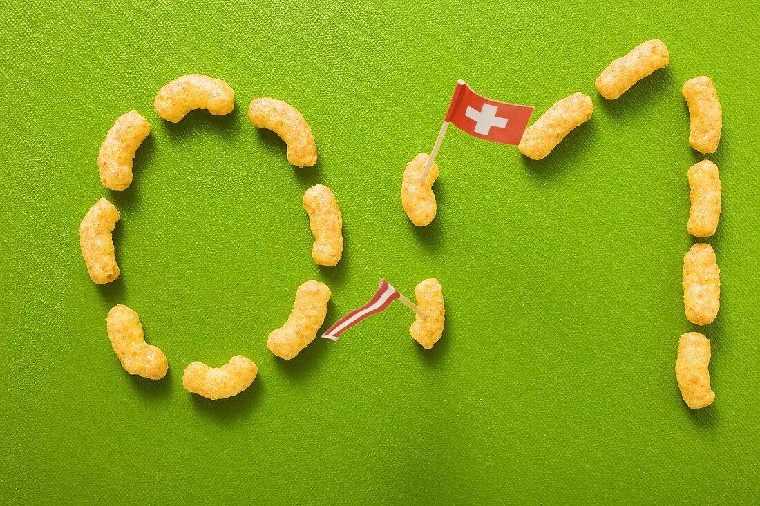 0:1 written in peanut puffs, flags of Austria & Switzerland