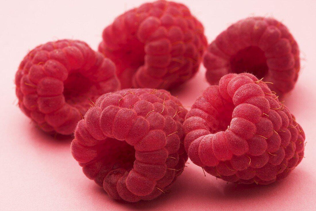 Five raspberries (close-up)