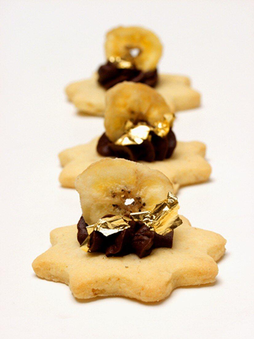 Three Sugar Cookies with Chocolate and a Slice of Banana
