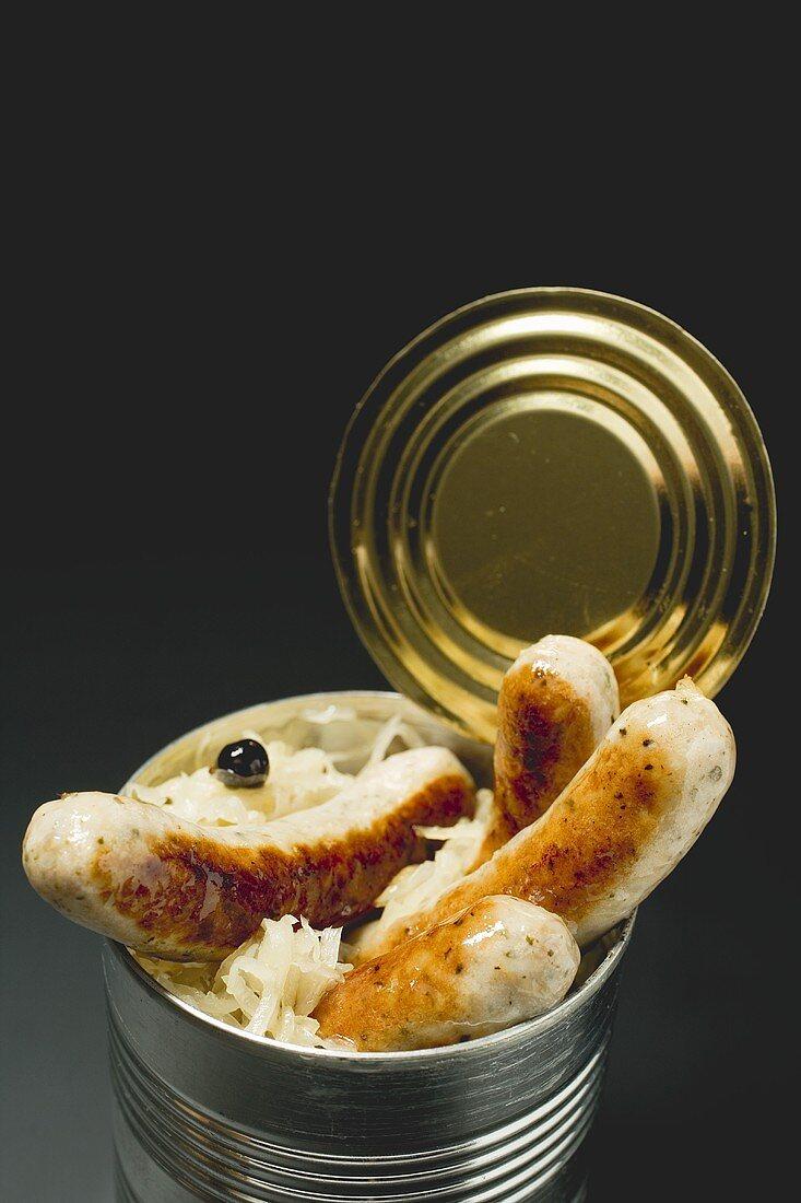 Sausages with sauerkraut in a food tin