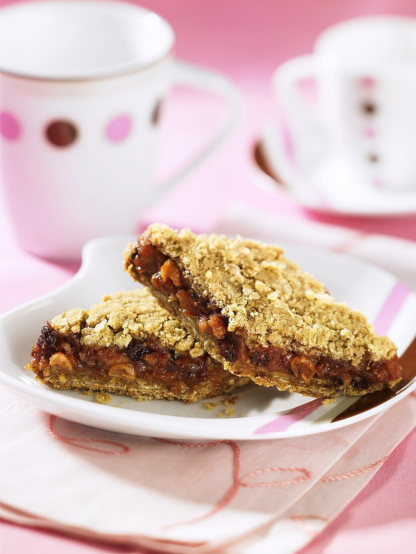 Two slices of dried fruit cake