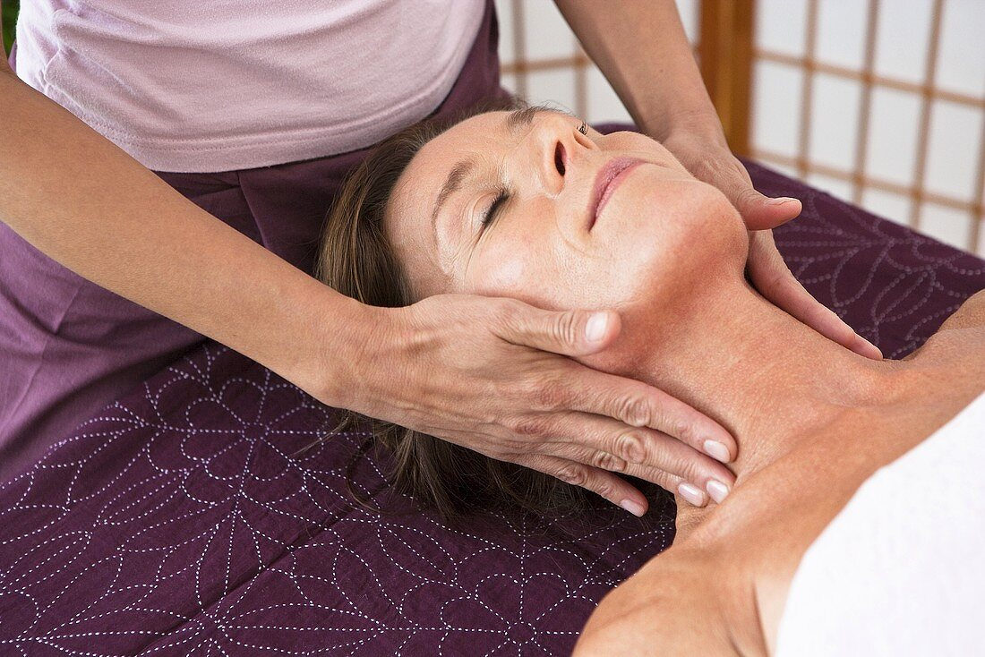 A woman having a face massage in a spa